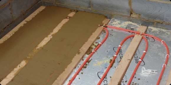 Water underfloor heating and aluminium spreader plates for Concrete floor upstairs